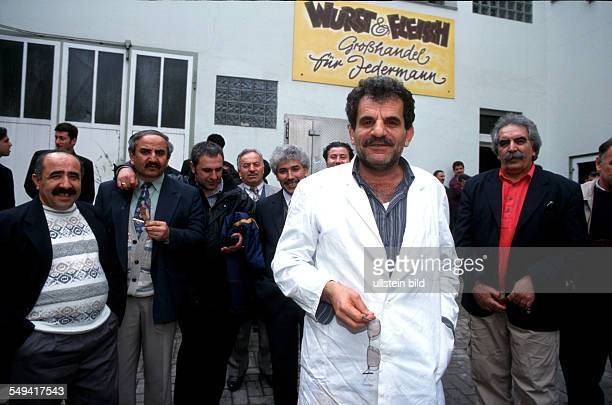 Turkish businessmen in Germany The manager in front of his butcher s court 3 employees