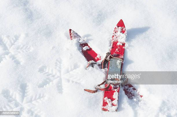 Germany, pair of red childrens ski on snow