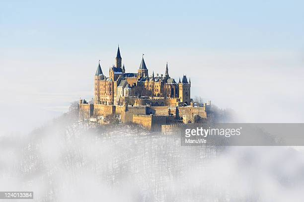 germany palace hohenzollern winter fog - castle stock photos and pictures