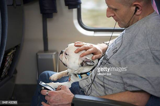 Germany passanger with dog is driving in a train -