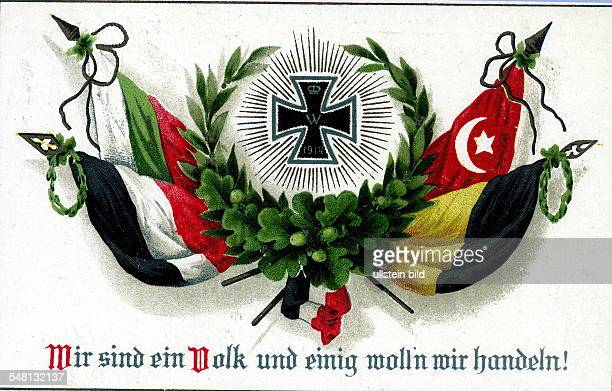 Patriotic postcards from WW I A laurel wreath and iron cross flanked by the symbolic alliance between the German Empire Bulgaria Turkey and...