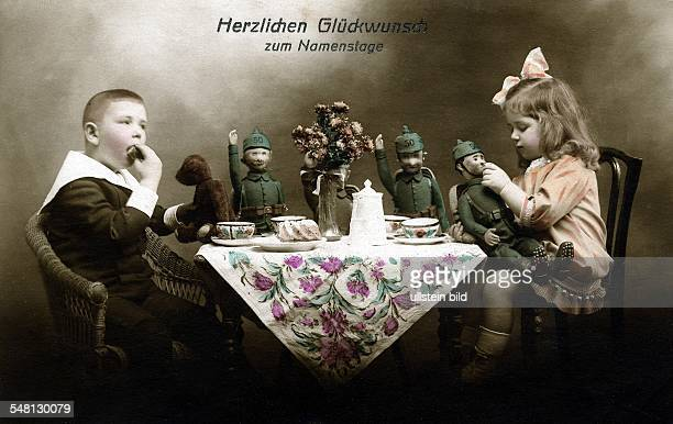 Patriotic postcards from WW I Children playing with German soldier dolls under a 'Happy Name Day' greeting 1914/1916 Photographer ullstein Heinrich