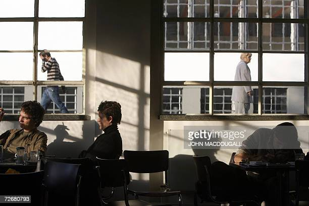 People sit in the cafeteria in one of the wings of the Bauhaus building in Dessau 30 November 2006 The building which housed the Bauhaus design...