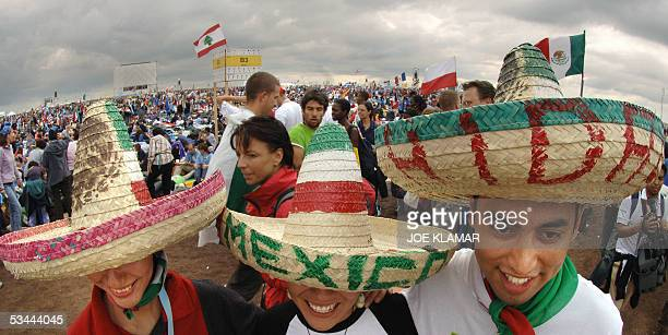 Pilgrims of the World Youth Day festival wearing Mexican hats arrive, 20 August 2005 at the Marienfeld near Kerpen, before pope Benedict XVI will...