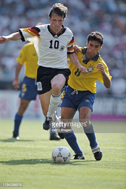 Germany player Lothar Matthaus is challenged by Luisinho of Brazil during the US Cup match at RFK Stadium on June 10, 1993 in Washington DC, North...