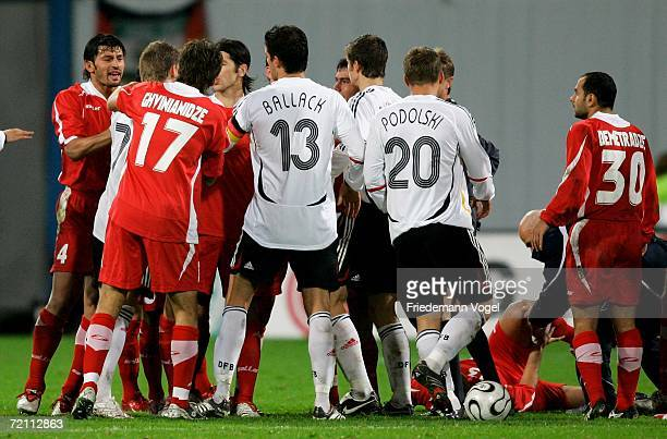 Germany players and Georgia players argue during the friendly match between Germany and Georgia at the Ostsee Stadium on October 7 2006 in Rostock...