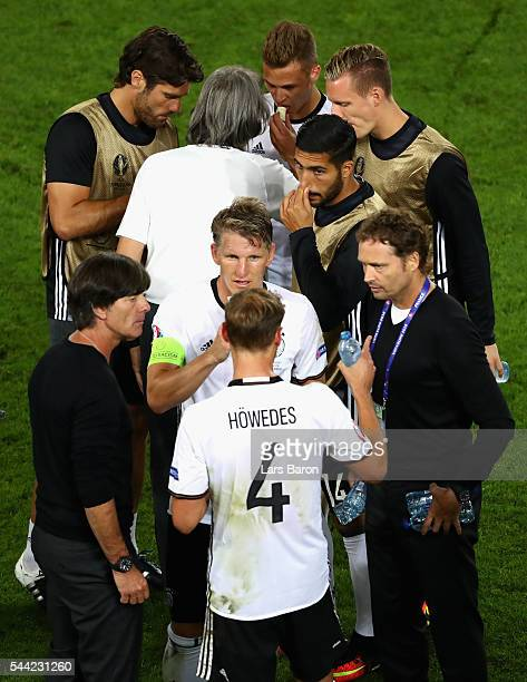Germany players and team staffs talk before the extra time during the UEFA EURO 2016 quarter final match between Germany and Italy at Stade Matmut...
