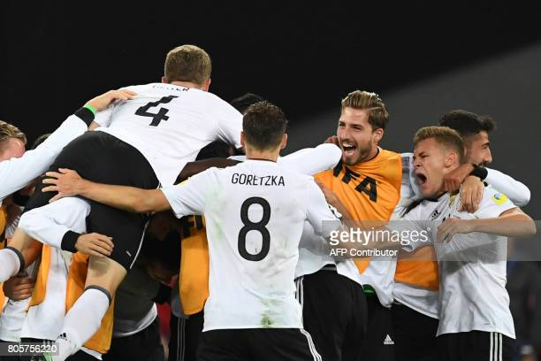 Germany players celebrate after beating Chile 10 in the 2017 Confederations Cup final football match between Chile and Germany at the Saint...