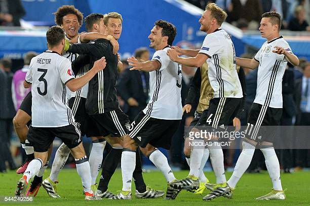 Germany players celebrate after beating Italy in the penalty shoot-out to clinch the match in the Euro 2016 quarter-final football match between...