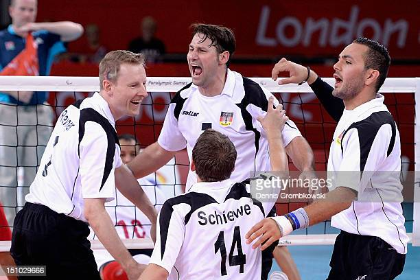 Germany players celebrate during the Men's Sitting Volleyball Preliminaries Pool A match between Germany and Morocco on day 2 of the London 2012...