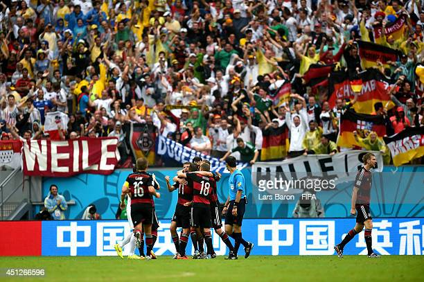 Germany players celebrate his team's first goal during the 2014 FIFA World Cup Brazil Group G match between USA and Germany at Arena Pernambuco on...