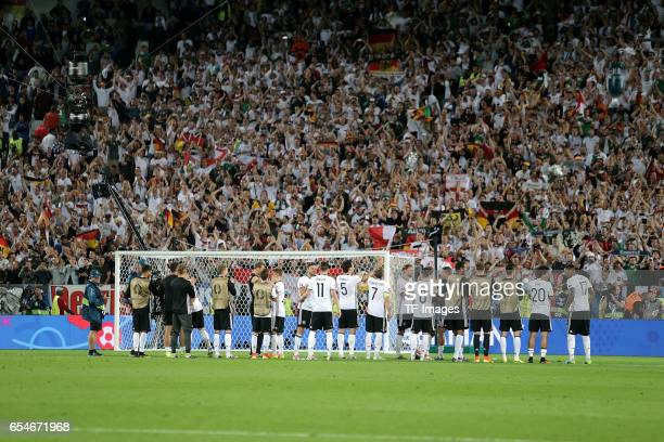 Germany players celebrate in front of their supporters after beating Italy on penalties during the UEFA EURO 2016 quarter final match between Germany...