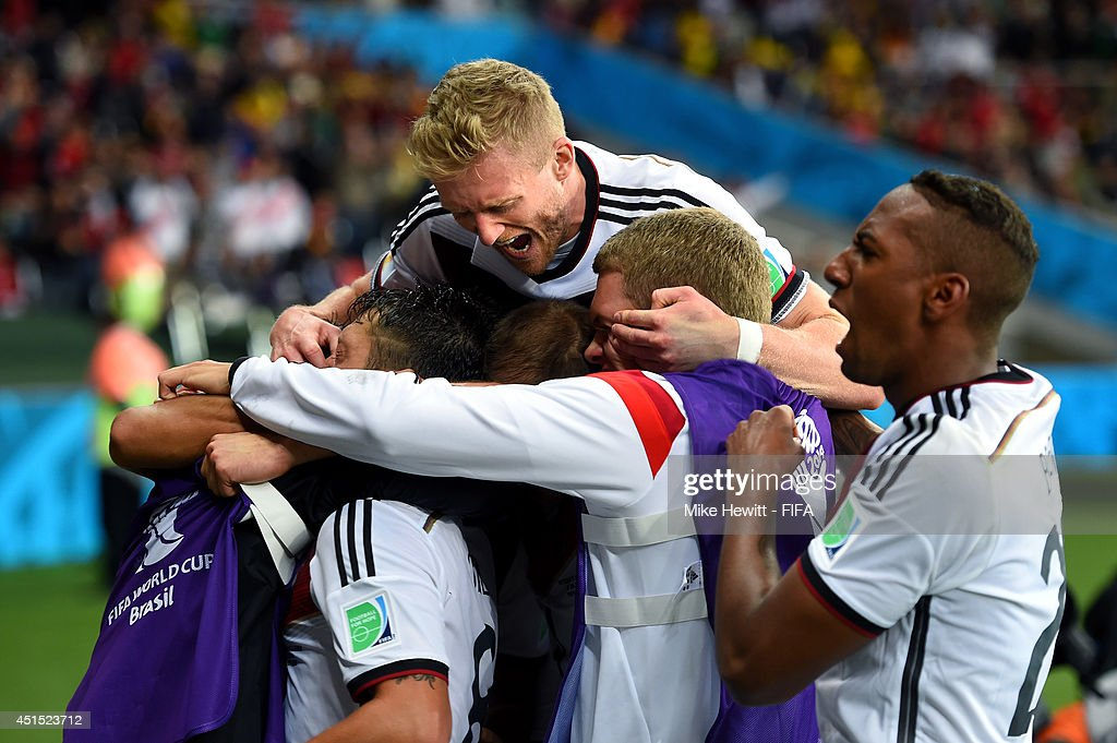 Germany players celebrate their second goal by Mesut Oezil during the 2014 FIFA World Cup Brazil Round of 16 match between Germany and Algeria at Estadio Beira-Rio on June 30, 2014 in Porto Alegre, Brazil.