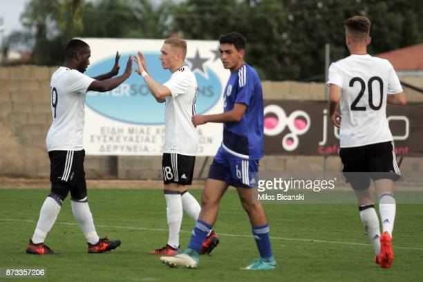 Germany players celebrate their team's second goal during the U19 International Friendly between U19 Cyprus and U19 Germany at Anagennisi Dherynia...