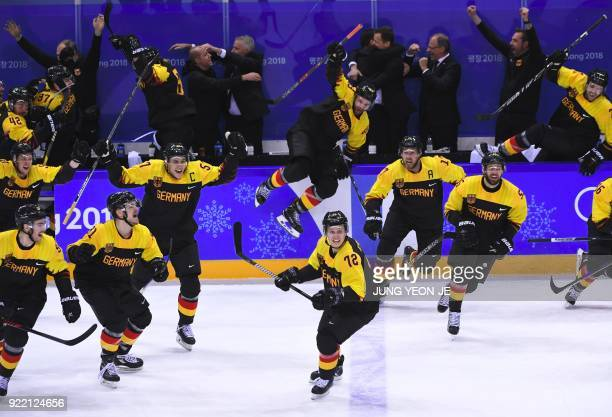 TOPSHOT Germany players celebrate their victory after the men's quarterfinal ice hockey match between Sweden and Germany during the Pyeongchang 2018...