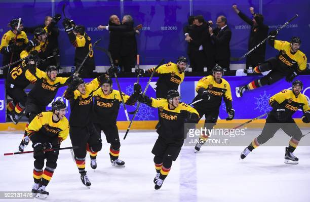 Germany players celebrate their victory after the men's quarterfinal ice hockey match between Sweden and Germany during the Pyeongchang 2018 Winter...