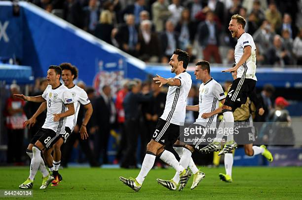 Germany players celebrate their win through the penalty shootout during the UEFA EURO 2016 quarter final match between Germany and Italy at Stade...