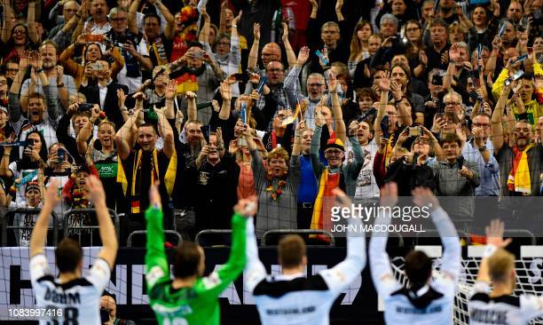 Germany players celebrate with the crowd after they defeated Serbia in the IHF Men's World Championship 2019 Group A handball match between Germany...