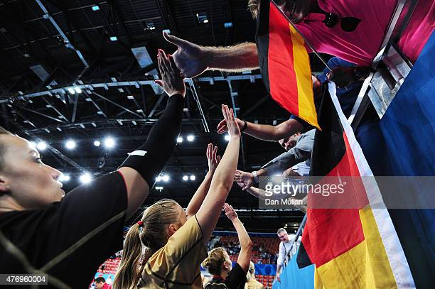 Germany players celebrate with the fans following their team's victory in the Women's Volleyball Preliminary Round match against Bulgarisduring day...