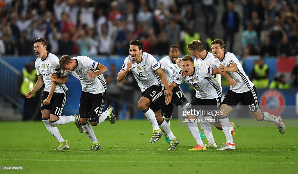 Germany players dash to celebrate their win through the penalty shootout after Jonas Hector scores to win the game after the UEFA EURO 2016 quarter final match between Germany and Italy at Stade Matmut Atlantique on July 2, 2016 in Bordeaux, France.