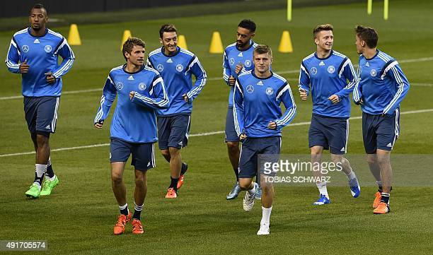 Germany players including Jerome Boateng Thomas Muller Mesut Ozil Sami Khedira Toni Kroos and Marco Reus attend a training session on the eve of...