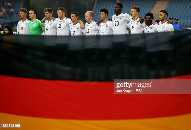 Germany players line up for the national anthems during the FIFA U17 World Cup India 2017 Round of 16 match between Colombia and Germany at...
