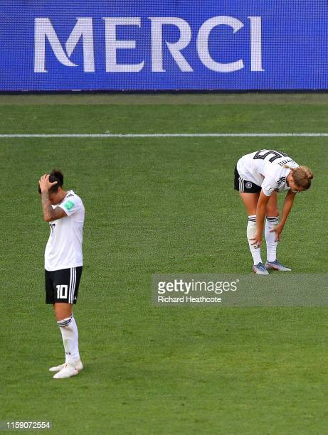 Germany players look dejected at fulltime after the 2019 FIFA Women's World Cup France Quarter Final match between Germany and Sweden at Roazhon Park...