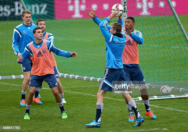 Germany players Matthias Ginter Jonas Hector Shkodran Mustafi Christoph Kramer and Jerome Boateng practice during a training session ahead of the...