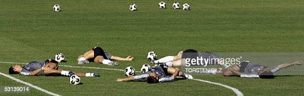 Players of the German national football team stretch during a training session 23 June 2005 in Herzogenaurach southern Germany The team played 22...