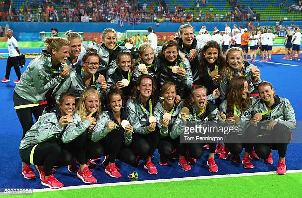 Germany players pose with their bronze medals after the medal ceremony for Women's Hockey on Day 14 of the Rio 2016 Olympic Games at the Olympic...