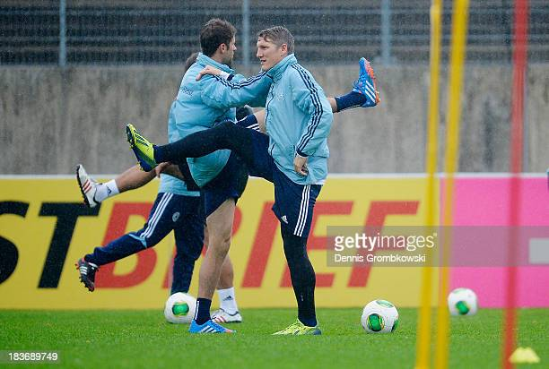 Germany players practice during a training session ahead of the FIFA 2014 World Cup Qualifier match against the Republic of Ireland on October 9 2013...