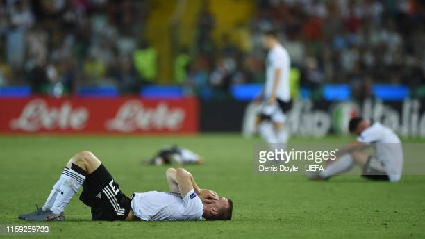 Germany players show their dejection at the end of the 2019 UEFA U-21 Final between Spain and Germany at Stadio Friuli on June 30, 2019 in Udine,...