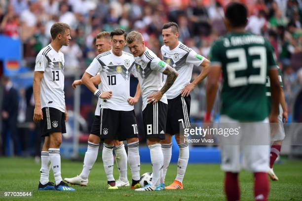 Germany players show their dejection following Mexico's first goal during the 2018 FIFA World Cup Russia group F match between Germany and Mexico at...