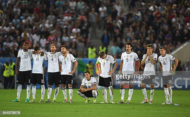 Germany players show their worry as they line up at the penalty shootout during the UEFA EURO 2016 quarter final match between Germany and Italy at...
