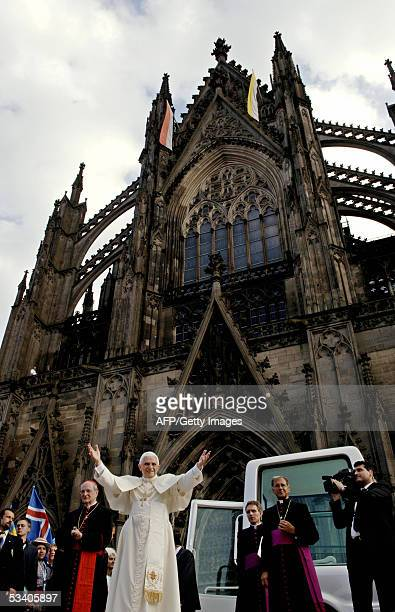 Pope Benedict XVI addresses pilgrims outside Cologne's Cathedral Germany next to the city's Archbishop Joachim Meisner 18 August 2005 on the first of...