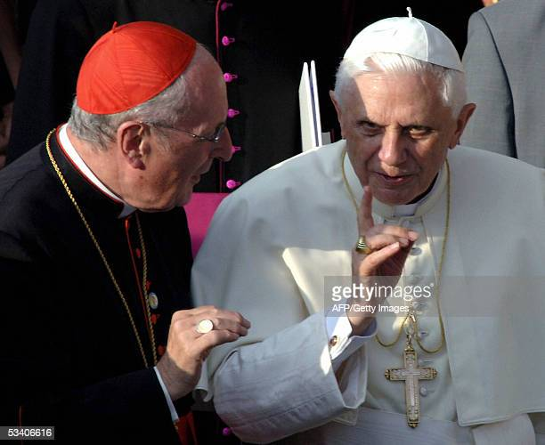 Pope Benedict XVI talks to Cologne's Archbishop Joachim Meisner outside Cologne's Cathedral Germany 18 August 2005 on the first of his groundbreaking...