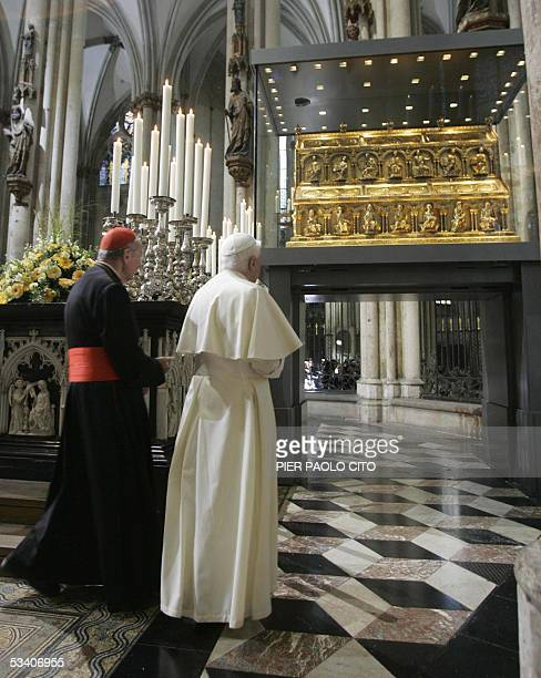 Pope Benedict XVI walks past the shrine inside Cologne's Cathedral 18 August 2005 in Cologne on the first day of his groundbreaking fourday visit to...