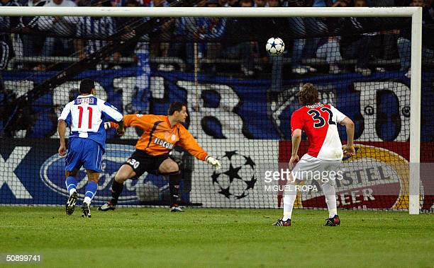 Porto's midfielder Carlos Alberta scores the opening goal past Monaco's Italian goalkeeper Flavio Roma during the Champions League football final...