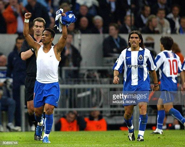 Porto's midfielder Carlos Alberto raises his arms after scoring against Monaco during the Champions League final football match 26 May 2004 at the...
