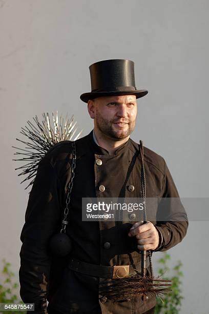 germany, portrait of chimney sweep - schornsteinfeger stock-fotos und bilder