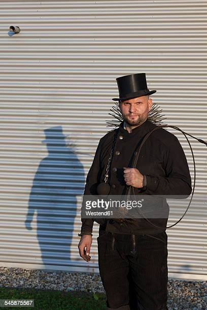 Germany, portrait of chimney sweep with working tools