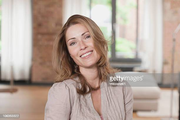 Germany, Portrait of woman, smiling