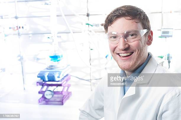 Germany, Portrait of young scientist smiling