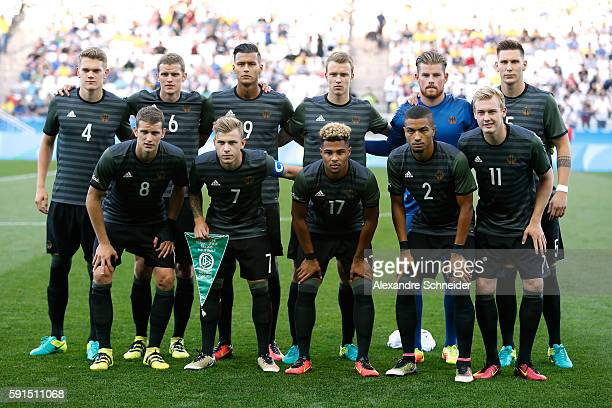 Germany pose for a team photo before the Men's Semifinal Football match between Nigeria and Germany on Day 12 of the Rio 2016 Olympic Games at Arena...