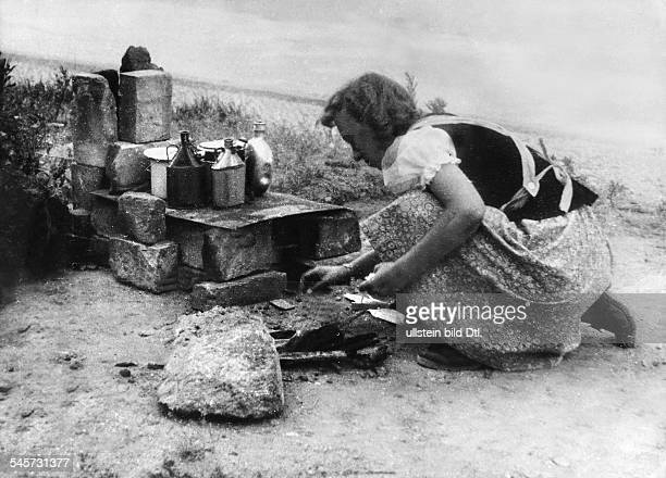 Germany Post War Years Food supply in Berlin 194549 A woman cooking outdoors May 1945