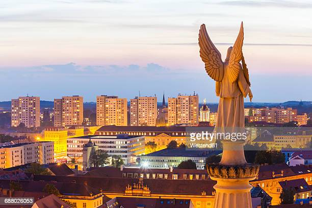 Germany, Potsdam, angel figurine of St. Nicholas church and concrete tower blocks in the background