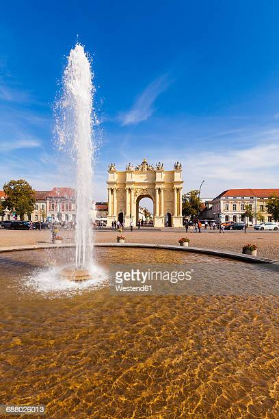 Germany, Potsdam, view to Brandenburg Gate with fountain in the foreground