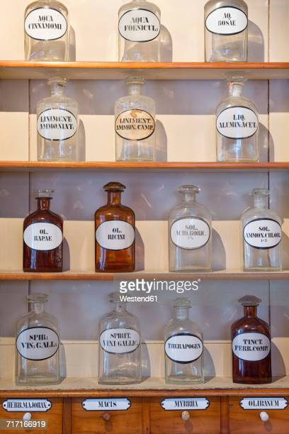 Germany, Radolfzell, shelves with glass bottles of historical pharmacy at municipal museum
