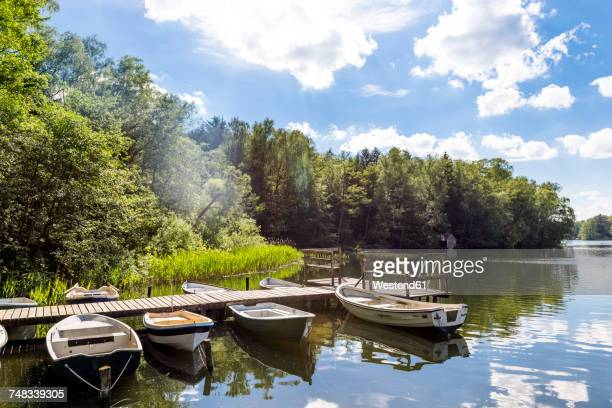 Germany, Ratzeburg, Salem, jetty with rowing boats at Pipersee