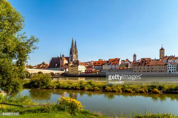 germany, regensburg, view of old town with cathedral and danube river in the foreground - regensburg stock photos and pictures